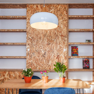 Inspiration for an industrial dining room remodel in Seville