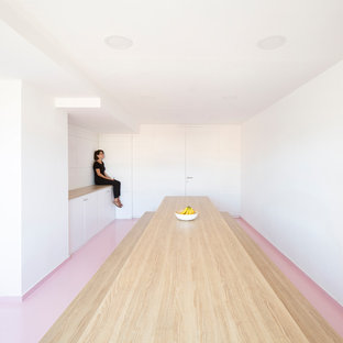 Mid-sized danish pink floor kitchen/dining room combo photo in Valencia with white walls