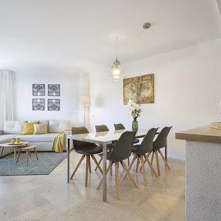 Foto de comedor actual, abierto, con paredes blancas y suelo beige