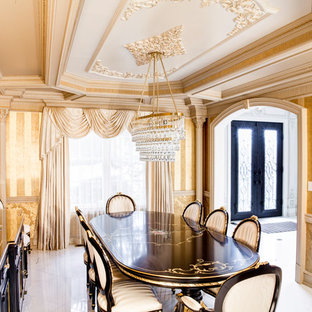 Inspiration for a mediterranean enclosed dining room in New York with yellow walls.