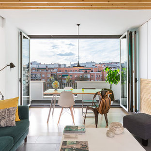 Example of a mid-sized danish great room design in Madrid with white walls and no fireplace