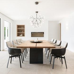 Ejemplo de comedor contemporáneo, grande, con paredes blancas y suelo beige