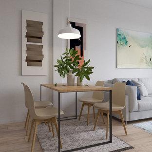 Ejemplo de comedor nórdico, pequeño, abierto, con paredes blancas