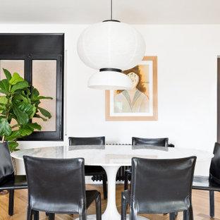 Imagen de comedor actual, de tamaño medio, abierto, con paredes blancas y suelo beige
