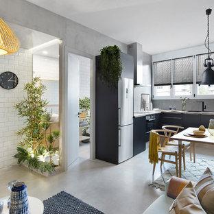 Diseño de comedor contemporáneo, de tamaño medio, abierto, sin chimenea, con paredes grises, suelo de cemento y suelo gris