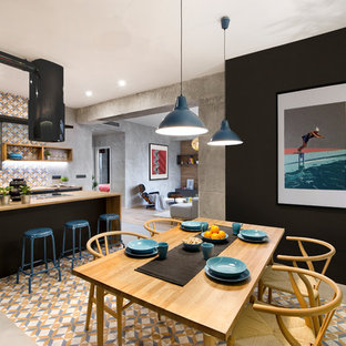 Inspiration for a mid-sized industrial multicolored floor kitchen/dining room combo remodel in Madrid with black walls