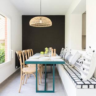 Foto de comedor contemporáneo con paredes blancas y suelo gris