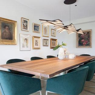 Imagen de comedor actual con paredes blancas