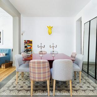 Imagen de comedor actual, de tamaño medio, cerrado, sin chimenea, con paredes blancas, suelo de baldosas de cerámica y suelo multicolor