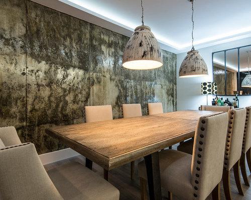 Sala da pranzo contemporanea con pareti con effetto metallico - Foto ...