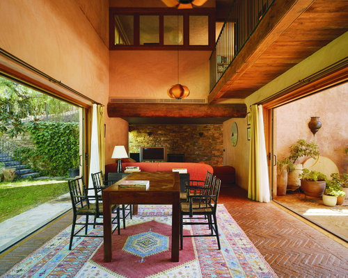 orange wall living room. Example of a large country brick floor great room design in Other with orange  walls 25 Best Farmhouse Dining Room Orange Walls Ideas
