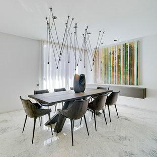 Ejemplo de comedor actual con paredes blancas y suelo blanco