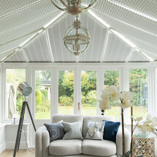 Traditional conservatory in Other with light hardwood flooring and beige floors.
