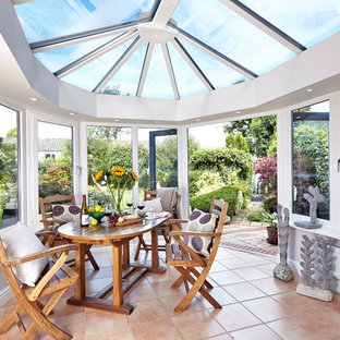Design ideas for a mediterranean conservatory in Berkshire with terracotta flooring, a glass ceiling and red floors.