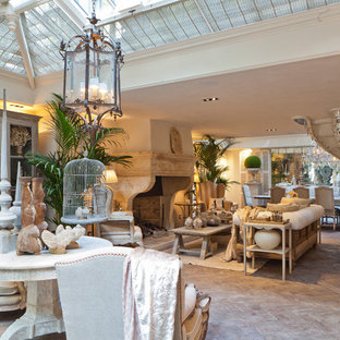 Design ideas for a large victorian conservatory in London with light hardwood flooring, a standard fireplace, a stone fireplace surround and a skylight.