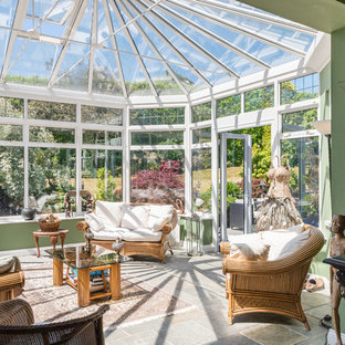 Photo of a medium sized world-inspired conservatory in Other with a standard ceiling and grey floors.