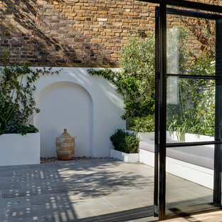 This is an example of a medium sized traditional conservatory in London.