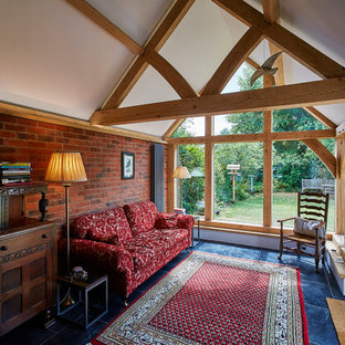 Photo of a medium sized rural conservatory in Berkshire with a standard ceiling and blue floors.