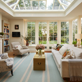 Inspiration for a timeless light wood floor sunroom remodel in London with a standard fireplace and a glass ceiling