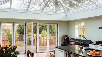 Orangery with glass roof and brick pillars