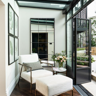 Inspiration for a small classic conservatory in London with dark hardwood flooring, a glass ceiling, brown floors and no fireplace.