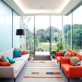 This is an example of a contemporary conservatory in Other with a standard ceiling and grey floors.
