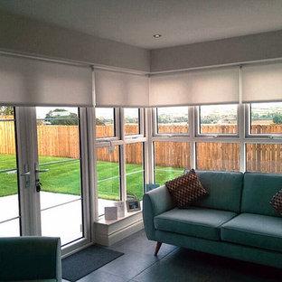 Scandinavian Inspired Sunroom Interior with Minimal Roller Blinds