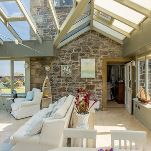 This is an example of a medium sized coastal conservatory in Other with ceramic flooring, a glass ceiling and beige floors.