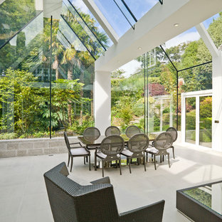 Contemporary conservatory in Cornwall with no fireplace and beige floors.