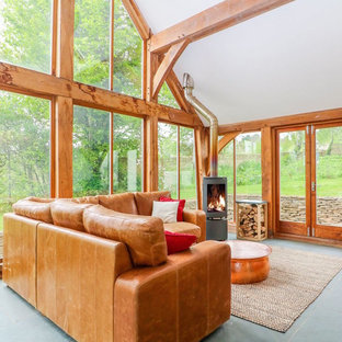 Stunning conservatory with natural materials and log burner
