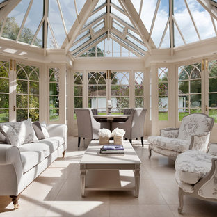 Large classic conservatory in Surrey with travertine flooring, a glass ceiling and beige floors.