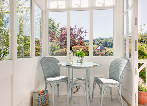 Use wicker and rattan for a tropical flavor all year round for Sunroom breakfast nook