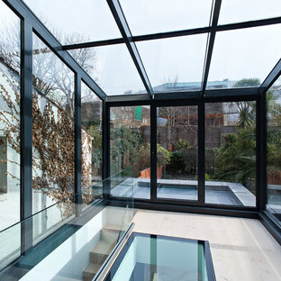 Photo of a medium sized contemporary conservatory in London.