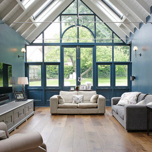 Design ideas for a large classic conservatory in Other with medium hardwood flooring, no fireplace, a standard ceiling and brown floors.