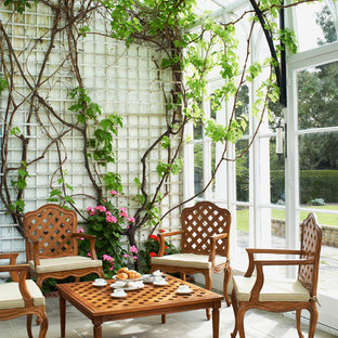 Design ideas for a traditional conservatory in London with no fireplace and a glass ceiling.