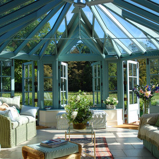 Design ideas for a victorian sunroom in Other with travertine floors and a glass ceiling.