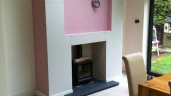 Woodburner in false chimney breast with recessed TV aperture