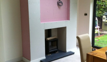 Woodburner in false chimney breast with recessed TV aperture