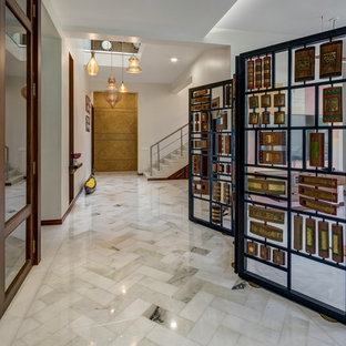 Mid-sized marble floor and gray floor hallway photo in Other with white walls