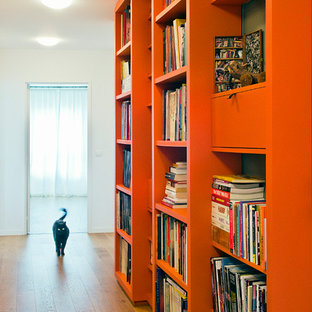 Inspiration for a mid-sized contemporary plywood floor and brown floor hallway remodel in Paris with beige walls