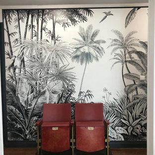 На фото: коридор среднего размера в стиле модернизм с белыми стенами, паркетным полом среднего тона, коричневым полом и обоями на стенах
