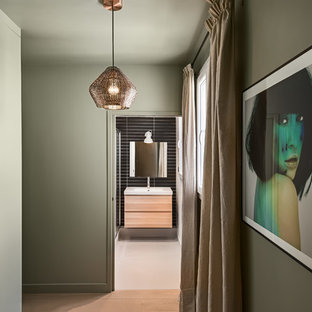 Inspiration for a small contemporary light wood floor hallway remodel in Paris with green walls