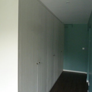 This is an example of a mid-sized beach style hallway in Bordeaux with blue walls, vinyl floors and brown floor.