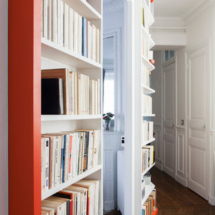 Inspiration for a large traditional hallway in Paris with white walls and medium hardwood floors.