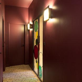 Example of a mid-sized trendy terrazzo floor and beige floor hallway design in Paris with red walls