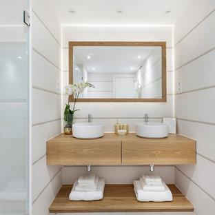Imagen de cuarto de baño contemporáneo con armarios con paneles lisos, puertas de armario de madera oscura, ducha empotrada, paredes blancas, lavabo sobreencimera, encimera de madera, ducha con puerta con bisagras y encimeras marrones