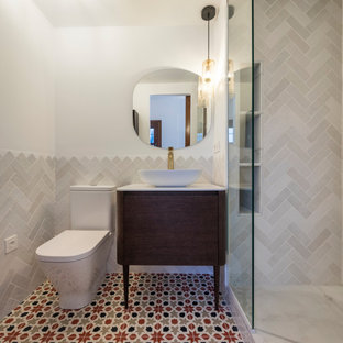 Inspiration for a small mediterranean master bathroom in Other with open cabinets, white cabinets, a corner shower, a two-piece toilet, white tile, ceramic tile, white walls, ceramic floors, a vessel sink, red floor and white benchtops.