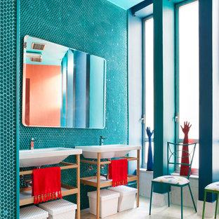 Imagen de cuarto de baño infantil, ecléctico, grande, con armarios abiertos, baldosas y/o azulejos azules, paredes azules, lavabo tipo consola, suelo blanco y baldosas y/o azulejos en mosaico