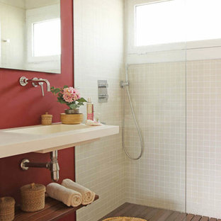 Inspiration for a mediterranean 3/4 beige tile orange floor bathroom remodel in Other with open cabinets, red walls, an integrated sink and white countertops