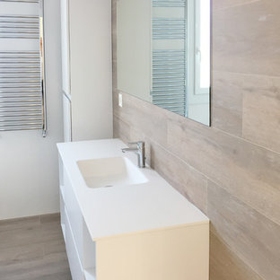 Design ideas for a large mediterranean ensuite bathroom in Bilbao with white cabinets, a built-in bath, a wall mounted toilet, brown tiles, brown walls, an integrated sink, engineered stone worktops, brown floors and a hinged door.